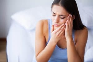 Teeth Pain. Beautiful Woman Suffering From Painful Toothache.
