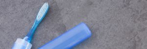 Toothbrush with plastic case - Blue background